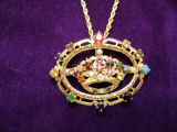 Pendant with jewels commemorating queens for whom Karen Thornton has created trains.