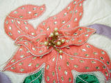 Close up of flower design created by master seamstress Karen Thornton