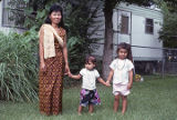 Heang Cottrell, a Cambodian dressmaker, with her children in Bayou La Batre, Alabama.