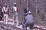 Henry Caffey, Arthur James, Willie Henderson, and John Cole on the tracks during a gandy dancer...
