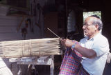 Kinn Kranh making a Cambodian fish trap at his home in Bayou La Batre.
