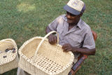 Eddie Campbell with a white oak basket at his home in Maplesville, Alabama.