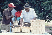 J. C. Williams and John Cox sellling their baskets at the Black Belt Folk Roots Festival in Eutaw,...