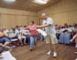 Reba Dell Windom and Blake Sizemore leading a song during the Camp FaSoLa youth session in...