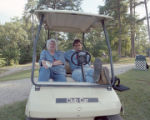 Shelbie Sheppard and Rodney Ivey in a golf cart at the Camp FaSoLa youth session in Anniston,...