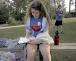 Grace Gilmore studying her songbook at the Camp FaSoLa youth session in Anniston, Alabama.
