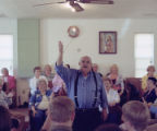 Coy Ivey leading a song at either the 107th or 108th session of the Lookout Mountain Sacred Harp...