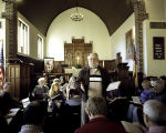 Oscar McGuire leading a song at the Sacred Harp singing at St. Dunstan's Episcopal Church in...