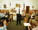 Henry Johnson leading a song at the 12th session of the annual Sacred Harp singing at Salem United...