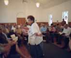 Reba Dell Windom leading a song at the 12th session of the annual Sacred Harp singing at Salem...