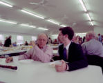 Buell Cobb and Jesse Pearlman Karlsberg eating lunch at the annual Henagar-Union Sacred Harp...