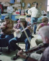 Ricky Harcrow playing the banjo at a social hosted by Coy and Marie Ivey on their property in...