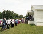 People in line to get food during the dinner on the grounds at the annual Henagar-Union Sacred...