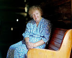 Elderly woman seated on a pew at the 95th session of the annual Labor Day Sacred Harp singing at...