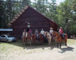 Local citizens on horses in front of the Shoal Creek Church in Cleburne County, Alabama, on the...
