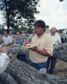 Rodney Ivey eating dinner on the grounds at the Lacy Memorial Sacred Harp singing in Ider, Alabama.