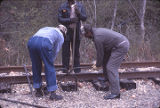 Cornelius Wright, Henry Caffey, and John Cole on the tracks during a gandy dancer reunion at the...