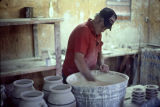 Jerry Brown mixing glaze before dipping vessels at his pottery shop in Hamilton, Alabama.