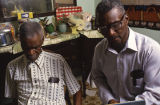 Dewey Williams and Japheth Jackson, Wiregrass Sacred Harp Singers, singing in a house in Ozark,...