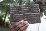 Japheth Jackson, one of the Wiregrass Sacred Harp Singers, holding an original printing plate used...
