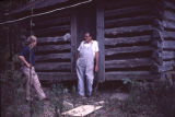 Arlin Moon in the doorway of a log cabin on his farm in Holly Spring, Alabama.