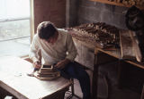 Matt Hand, son and student of David Hand, in his father's furniture workshop in Guntersville,...