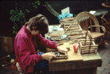 Matt Hand, son and student of furniture maker David Hand, demonstrating in the courtyard of the...