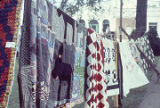 Quilts made by the Clinton Quilting Bee hanging at the Black Belt Folk Roots Festival in Eutaw,...