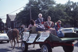 Mule-drawn wagon carrying the Fall Festival Queen, the Mule-Day Queen, and the Donkey Queen in the...
