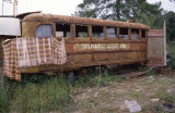 "Rusted bus on the property of Charlie Lucas (""Tin Man"") in Pink Lily, Alabama."