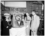 Richard Covey accepting Wisdom painting, 1957
