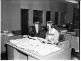 Ruth Hicks, Mrs. Charles Barrett prepare Friends mailout, 1961