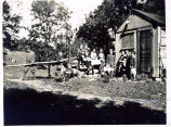 Students of the Marietta Johnson School of Organic Education gather around a cottage