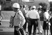 Police officer standing outside during a civil rights demonstration in Luverne, Alabama.