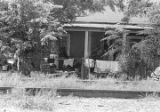 Several people on the porch of a house in Newtown, a neighborhood in Montgomery, Alabama.