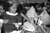Barbara Howard Flowers with her sister, Princilla Howard, and another women, seated at a table at...