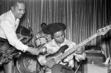 Joe Frank, a member of Bobby Moore and the Rhythm Aces, playing the bass guitar on stage at the...