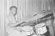 John Baldwin, a member of Bobby Moore and the Rhythm Aces, playing the drums on stage at the...