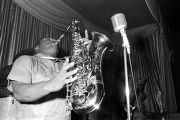 Bobby Moore playing the saxophone on stage at the Laicos Club in Montgomery, Alabama, during a...