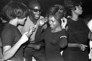 Dancer on the dance floor with customers at the Laicos Club in Montgomery, Alabama, during a...