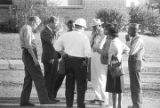 Representative Alton Turner, James Kolb, and others, talking outside during a civil rights...