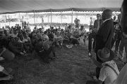 "Man speaking to an audience under a tent during the ""March Against Fear"" begun by James..."