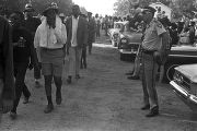 "Participants in the ""March Against Fear"" begun by James Meredith, walking down a dirt..."