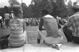 "Two young women talking while seated at a rest stop during the ""March Against Fear""..."