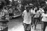 "Participants in the ""March Against Fear"" begun by James Meredith, walking down the..."
