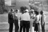 Representative Alton Turner, Willie Kolb, James Kolb, and others, talking outside during a civil...