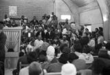 Man speaking to Martin Luther King, Jr., during a meeting at a church building in Greenville,...