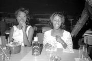 Susie Sanders Hubbard and another young woman, seated at a table at the Elks Club in Montgomery,...