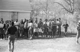 Group of young men and women clapping and singing before a meeting at Harrison Street Baptist...