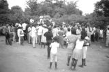 Crowd gathered outdoors in Montgomery, Alabama, during a civil rights demonstration.